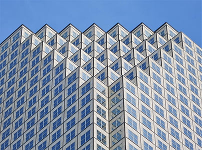 white and blue geometric high-rise building at daytime