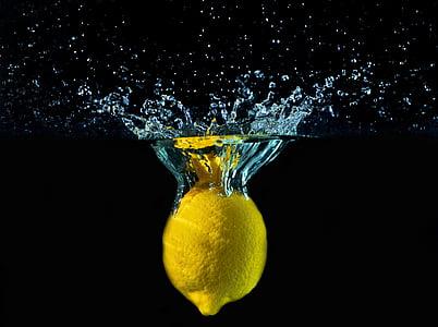 yellow lemon dropped in body of water