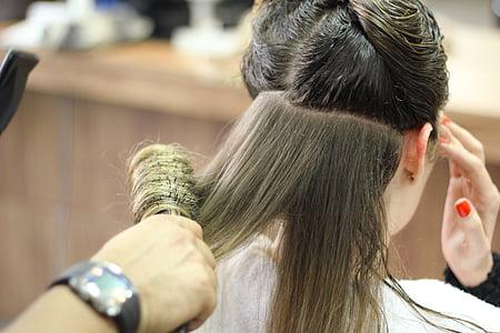 person holding black hair brush