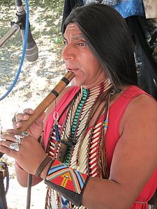 Native American Indian playing bamboo flute