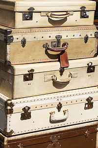 white and brown suit cases