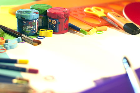 assorted colored paint bottles and art brush with scissors