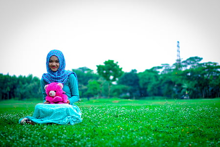 woman siting on grass field