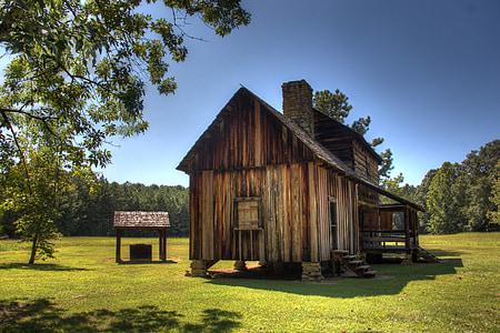 brown wooden house on green grass field