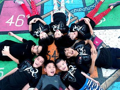children, lying down in circle, boys, girls, kids, people