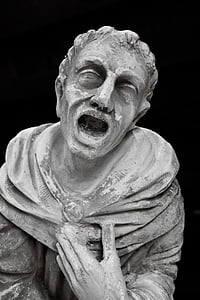 stone statue of screaming man
