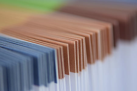 shallow-focus photography of papers