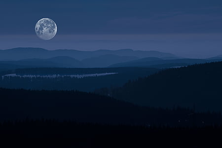 photography of mountain range under full moon