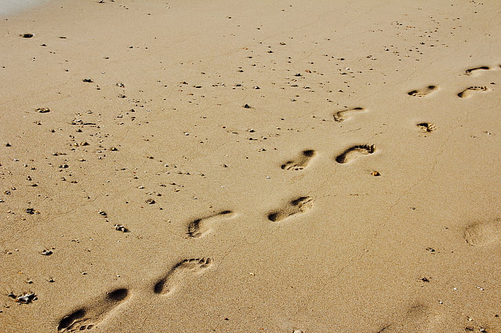 foot steps on sand