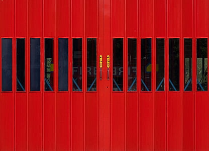 closed red wooden doors with glass at daytime