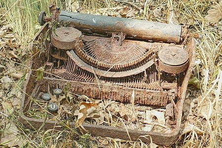 rusted vintage brown typewriter