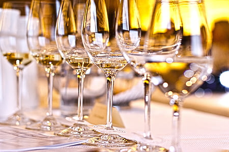 selective focus photography of wine glasses