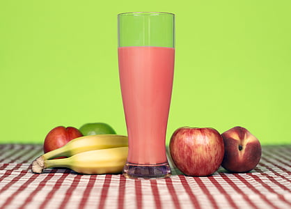 red apple near banana and clear glass cup