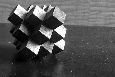 close up photography of geometric cube