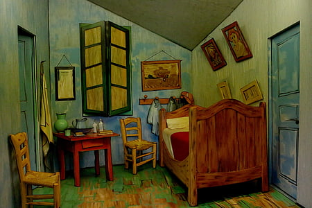 brown bed and red table with chairs painting