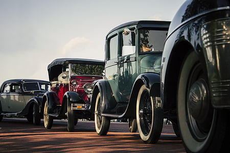classic green vehicle on road