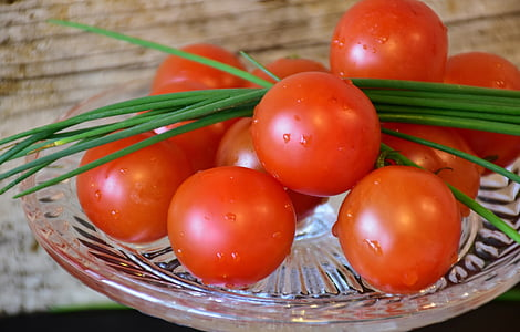 orange tomatoes on round glass plate