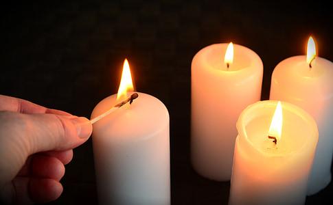 four lighted pillar candles