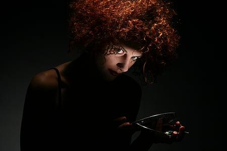 woman in black spaghetti-strap top