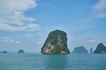 green rock monolith