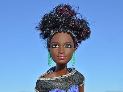 Barbie doll wearing gray top