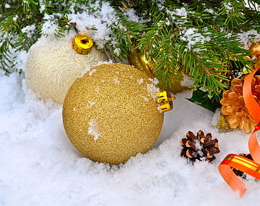 two brown and beige baubles on white snow