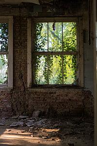 white framed window on brick wall