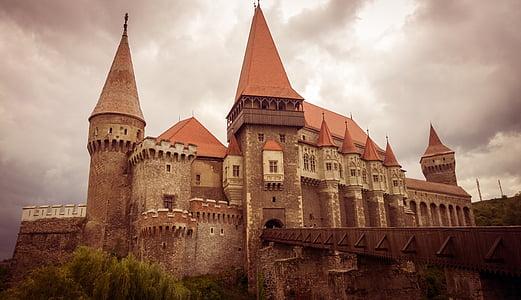 brown concrete castle under thick clouds photo
