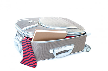 opened gray and white softside luggage