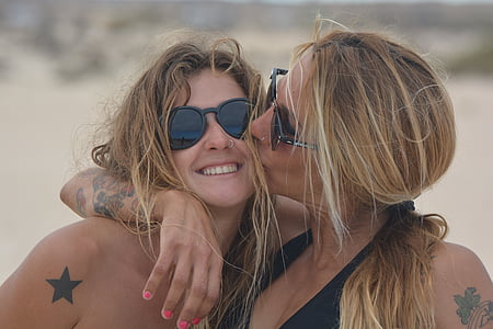 woman kissing woman on her cheek