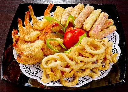 tempura, green vegetable, and calamari on brown table