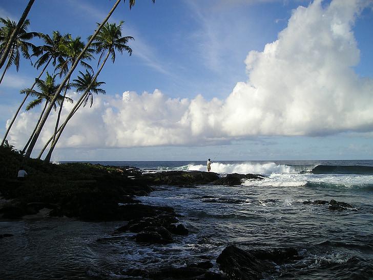 seawave splashing on rocks