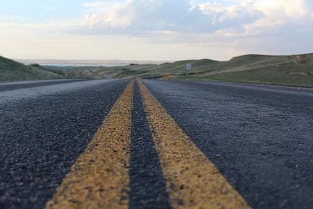 yellow lined asphalt road