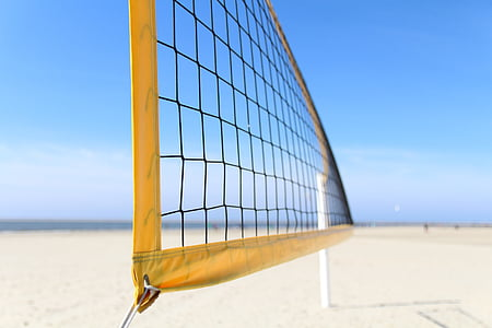 close-up photography of yellow volleyball net on the beach