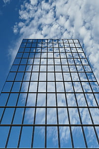 low-angle photography of glass curtain building