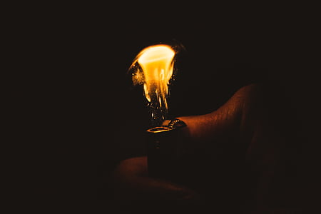 closeup photo of person using lighter