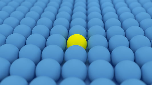 yellow ball surrounded by blue balls