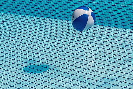 white and blue inflatable pool ball