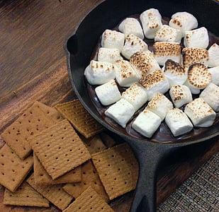 white marshmallows on black pan