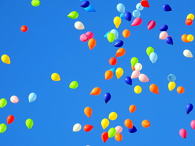 assorted-colored balloons floating in sky
