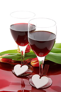 two red wine glasses filled with wine