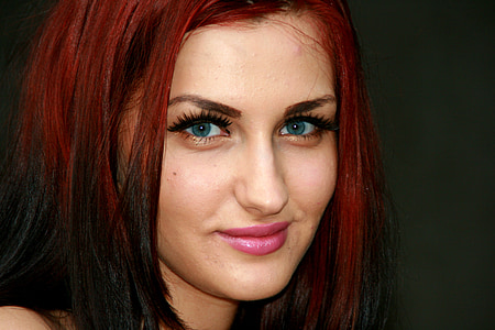 woman wearing pink lipstick and red hair