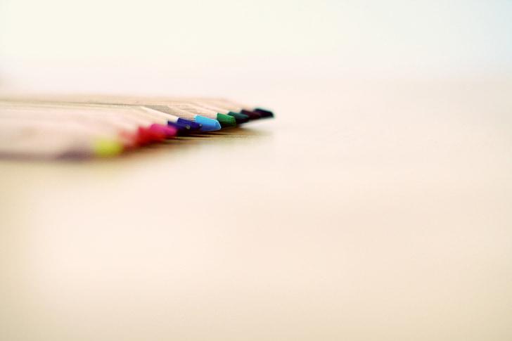 selective focus photograph of color pencils