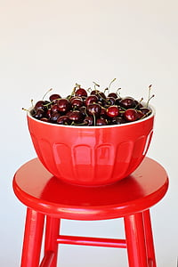 round red fruit lot filled red bowl