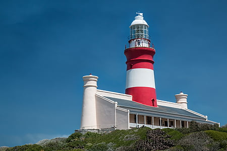 white and red lighthouse landscape photography