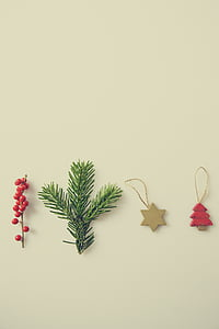 three Christmas-themed ornaments