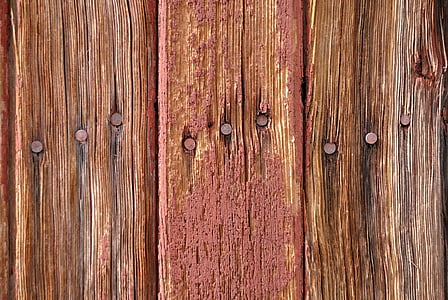 flat lay photography of nail fastened on brown wooden planks