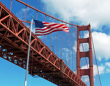 flag of U.S.A. beside Golden Gate Bridge