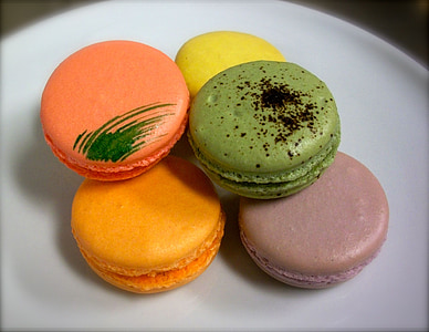 assorted-color macaroons on white plate
