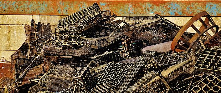 pile of gray scrap parts near wall